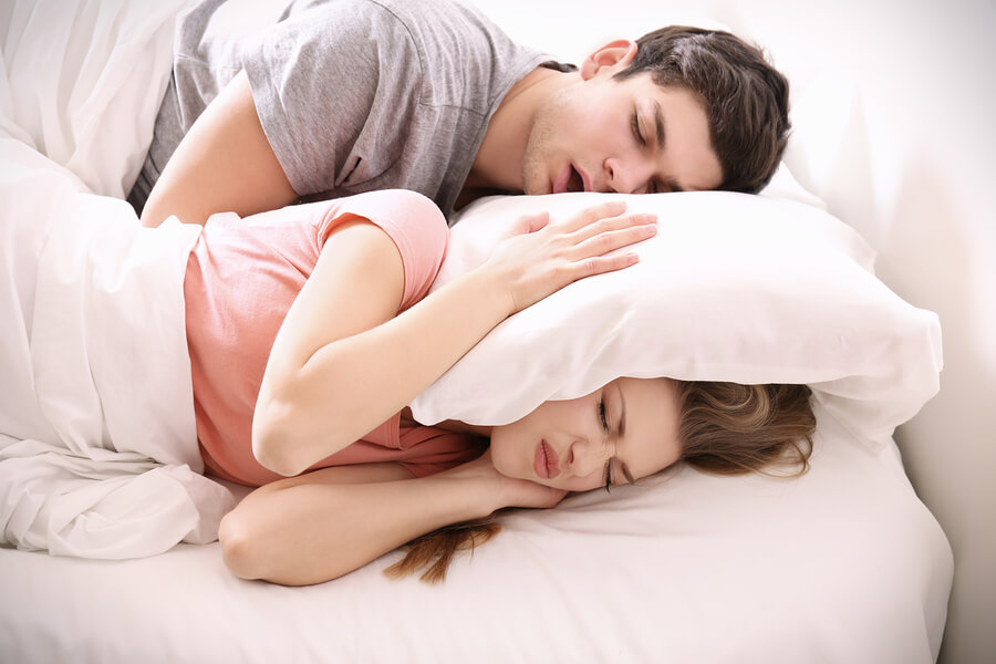 couple laying down in bed