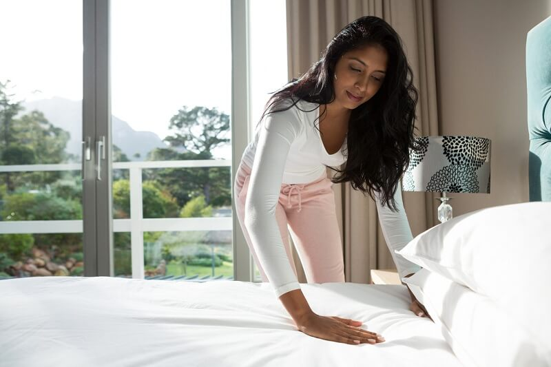 woman about to get into bed
