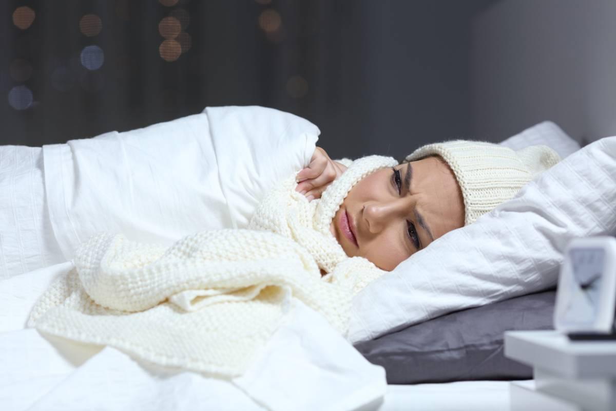woman underneath white blanket