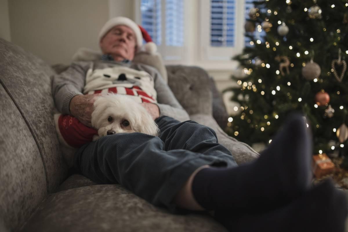 man with santa hat sleeping