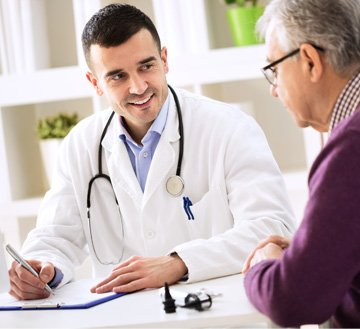 stock image shows doctor talking to patient image