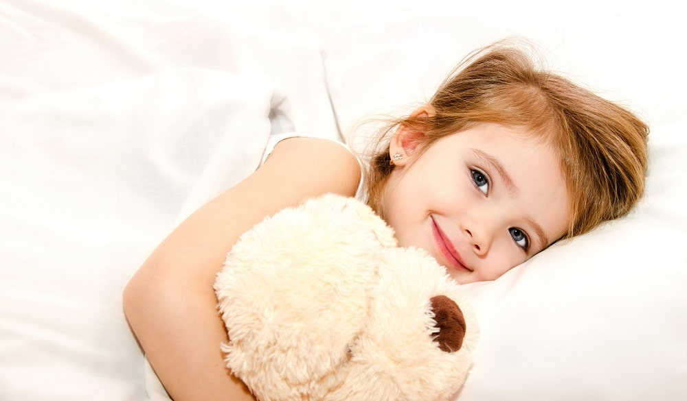 stock image shows sleeping baby with tedibar image