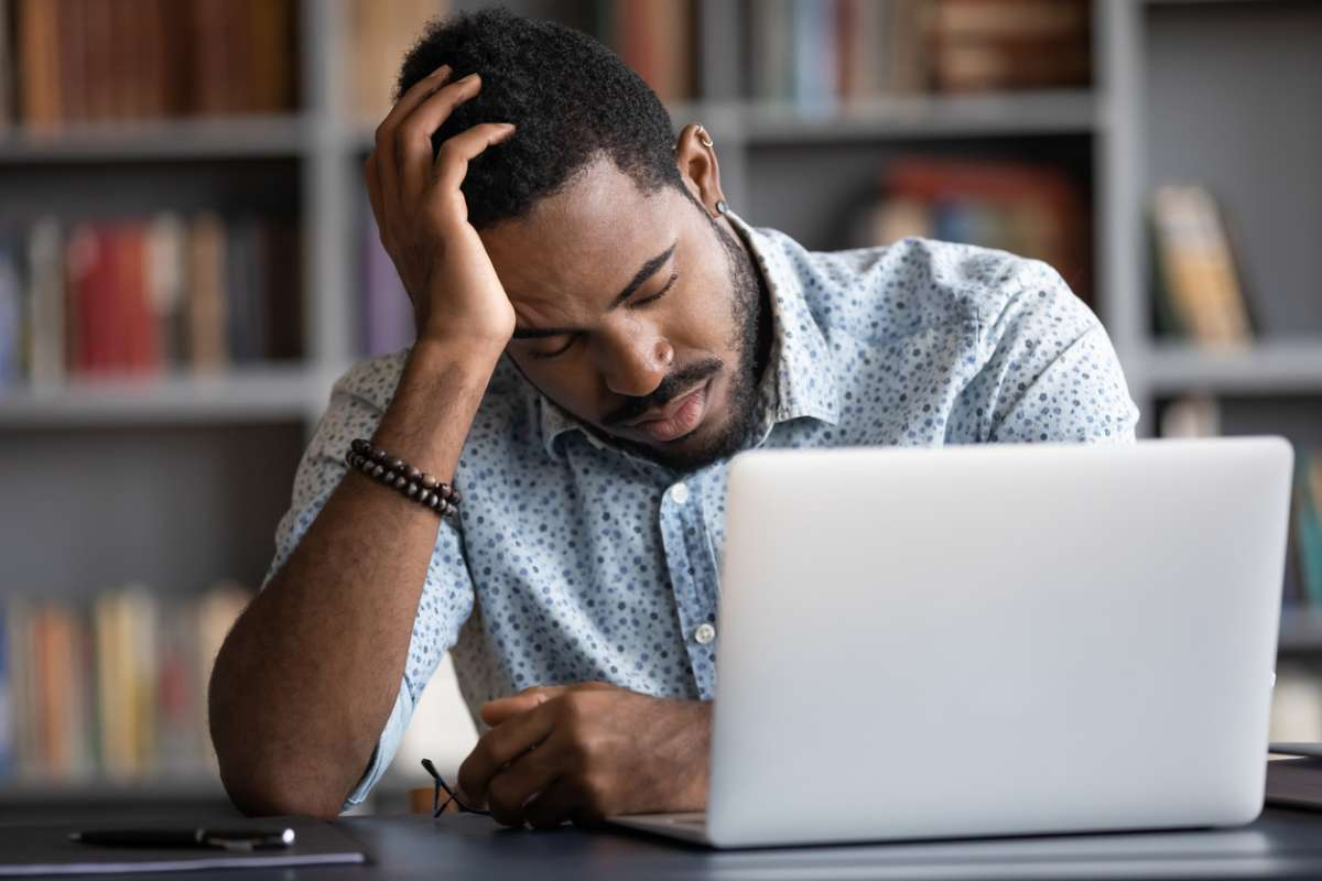 Man at a desk worrying about the dangers of narcolepsy