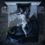 Woman in bed who got when when she fell asleep